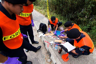 Major Lobzang training a cadre of police officers as forensic specialists