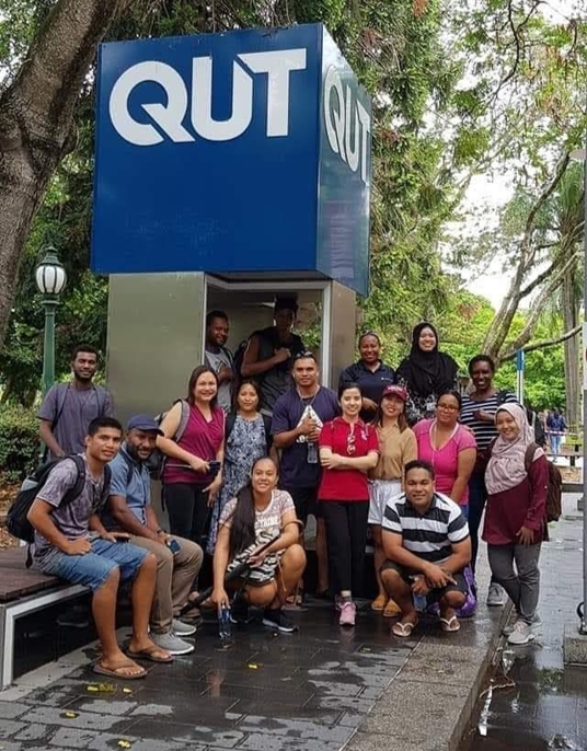 Australia Awards scholar Tshering Sydon of Bhutan with her classmates at the Queensland University of Technology campus before COVID-19